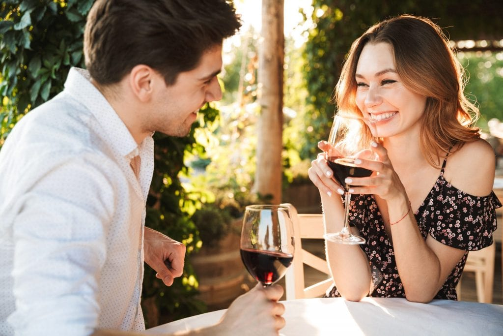 couple sharing a glass of wine