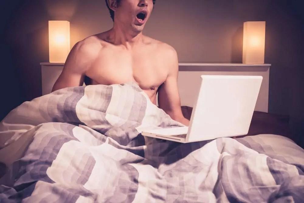 man ejaculating while watching porn