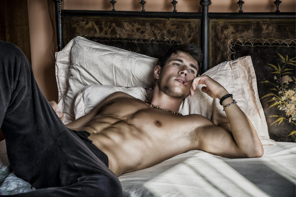 sexy man laying in bed