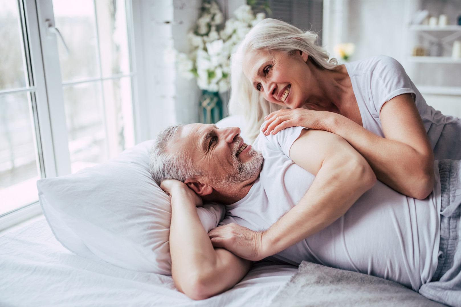 older couple in bed together