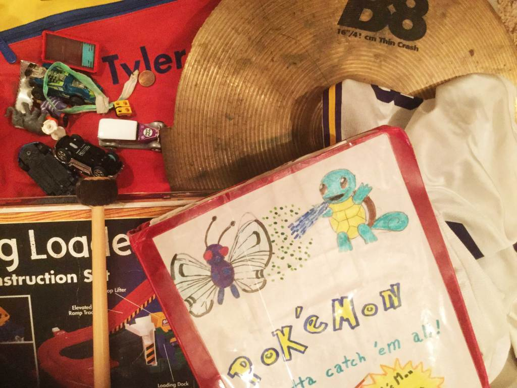 Some emotional items worth keeping; a lego block, a cymbal, Pokemon art, a train and track. These items represent happy smiles and happy tears!