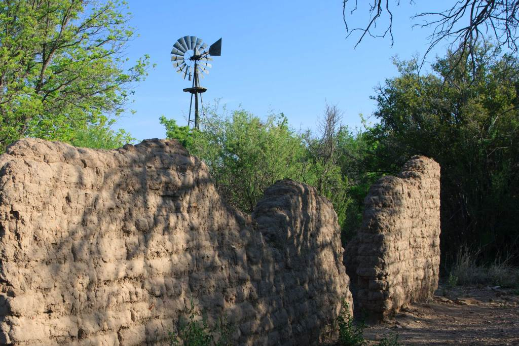 Pictured are the adobe remains of the Sam Nail Ranch; including the wind mill water pump that provides water to the animal and plant life.