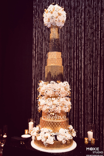Wedding Cakes in Las Vegas   cakelava SIMONE AND PAT   as seen on Food Network  Ridiculous Cakes    7 foot tall  wedding cake with handcrafted flowers and bling  Photo  Moxie Studio