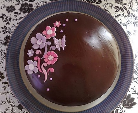 Chocolate Anniversary Cake With Pink And Purple Flowers