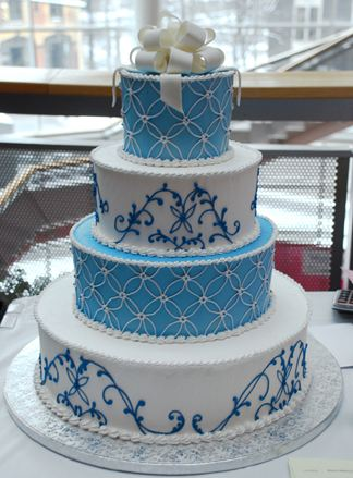 Four Tier Turquoise And White Wedding Cake With White Bow