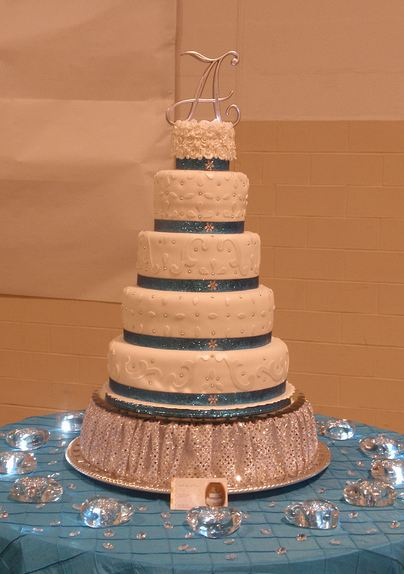 Four Tier Sweet 16 Birthday Cake In White Jpg 1 Comment
