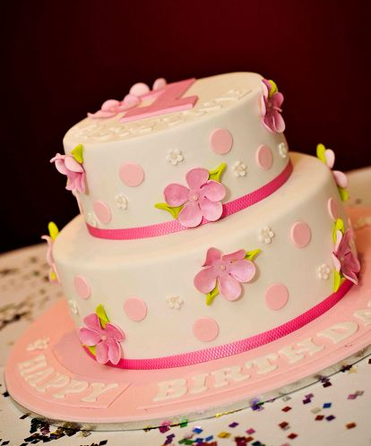 Two Tier White First Birthday Cake With Pink Pokadots And