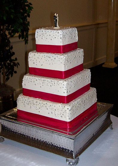 Four Tier Rectangular White Butter Cream Wedding Cake With