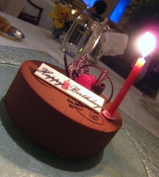 Round Simple Chocolate Birthday Cake With Red Candle Jpg