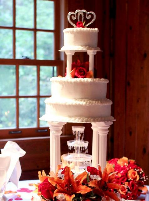 Multiple Tier Wedding Cake With Roman Columns And Fontain