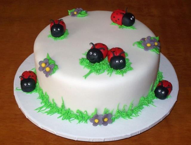 White Round Cake With Smiling Ladybugs Jpg 1 Comment