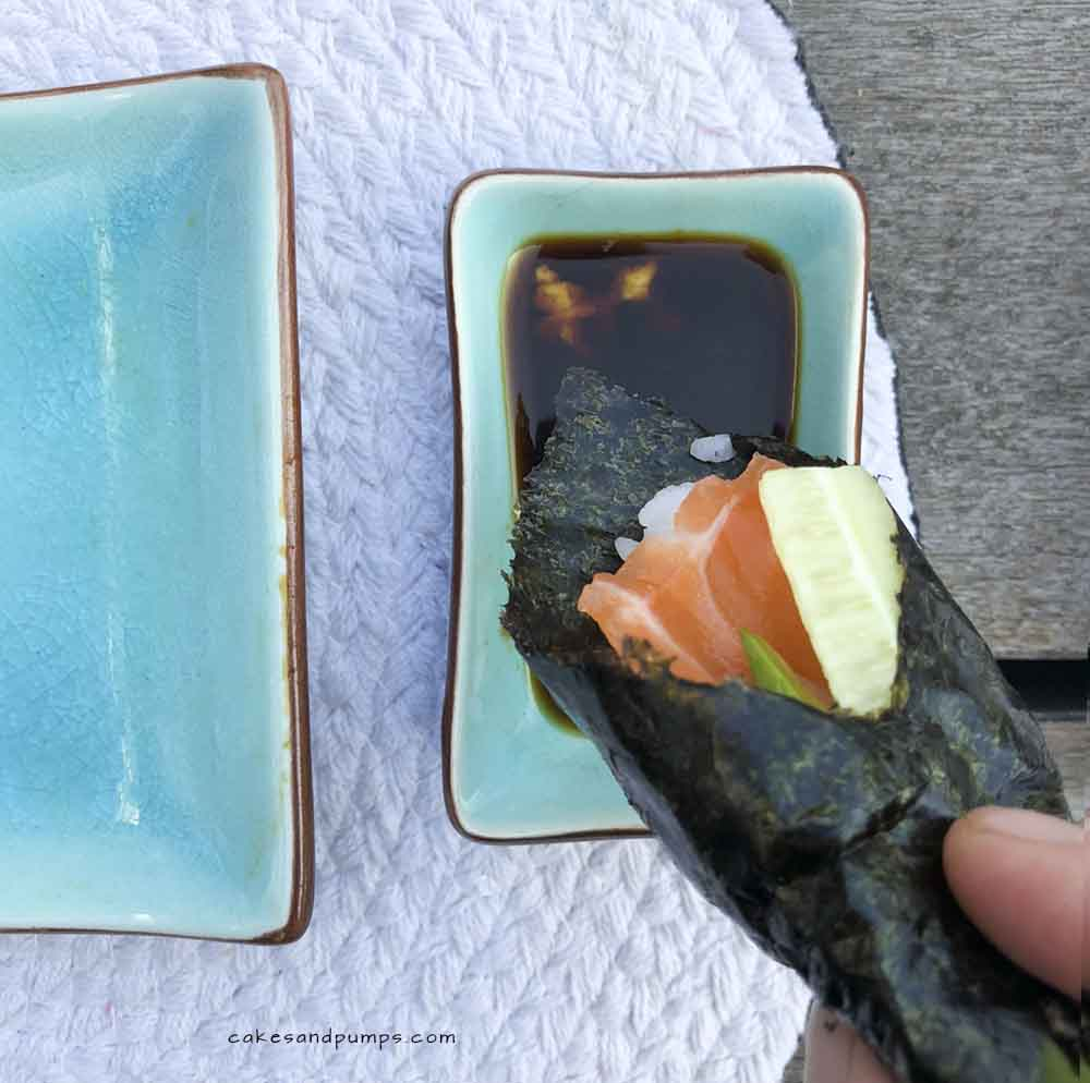 Dipping the homemade sushi into the soysauce, cakesandpumps.com