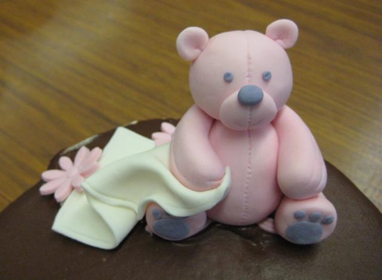 Gumpaste teddy bear with her blankie.