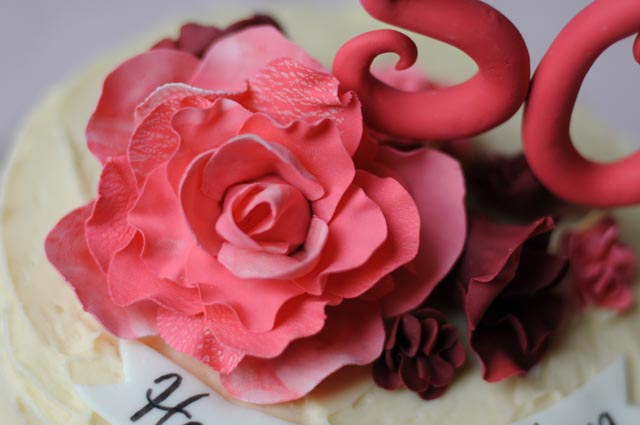 Rustic Birthday Cake with Roses and Carnations Close Up
