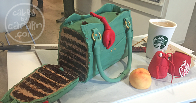 Purse cake with lobster, Coca-Cola, Starbucks, a peach and a confidential folder. Cut view.