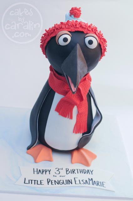 Muppet Penguin cake with hat and scarf