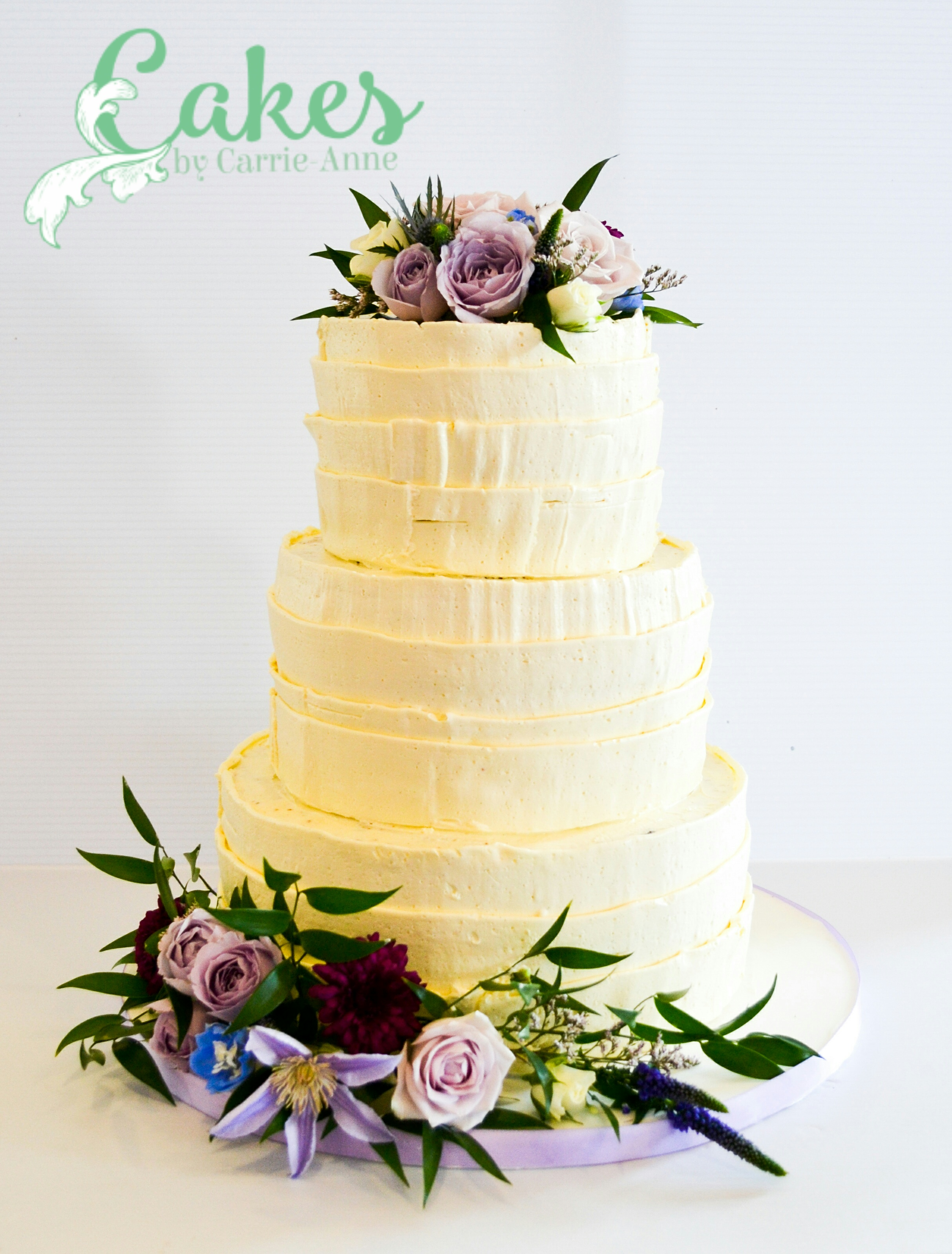 3 tier rustic buttercream wedding cake with purple florals – Cakes ...