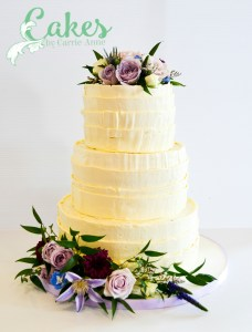 3 tier rustic wedding cake with purple florals