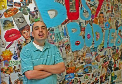 ABC Adult Day Program, Calvin posing at collage wall
