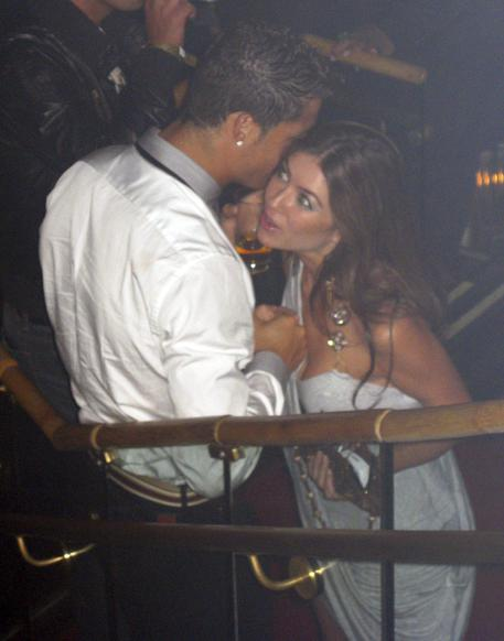 In this June 2009 photo made available to the Associated Press on Friday Oct. 5, 2018, soccer star Cristiano Ronaldo is pictured with Kathryn Mayorga in Rain Nightclub in Las Vegas.  (Matrixpictures via AP) NO SALES NO ARCHIVE MANDATORY CREDIT [CopyrightNotice: MATRIXPICTURES.CO.UK]