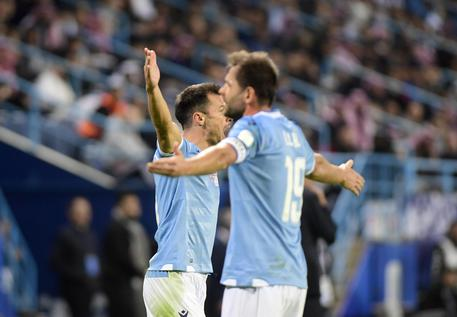 Lazio players celebrate after the score during their Super Cup match against Juventus at King Saud University Stadium, in Riyadh, Saudi Arabia, Sunday, Dec. 22, 2019. (ANSA/AP Photo/Nasser Alharbi) [CopyrightNotice: Copyright 2019 The Associated Press. All rights reserved]