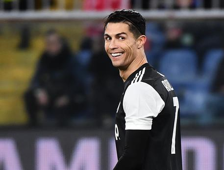Juventus' Cristiano Ronaldo (R) smiles during the Italian Serie A soccer match UC Sampdoria vs Juventus FC at Luigi Ferraris stadium in Genoa, Italy, 18 December 2019. ANSA/LUCA ZENNARO