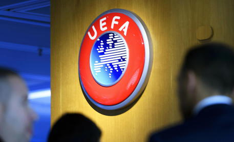 epa08337222 (FILE) - The UEFA logo on display after the meeting of the UEFA Executive Committee at the UEFA headquarters in Nyon, Switzerland, 07 December 2017 (re-issued on 01 April 2020). The UEFA has postponed on 01 April all planned matches of the national team's in June until further notice. The same applies to Champions and Europa League matches of this season.  EPA/LAURENT GILLIERON *** Local Caption *** 55950362