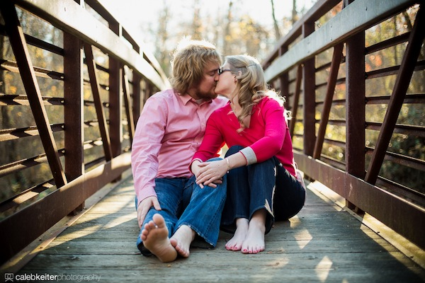 A portrait of a couple kissing on a bridge outside of Richmond, VA