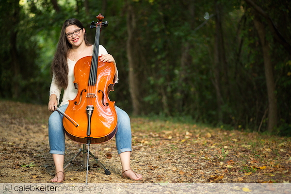 Aly's senior picture with her cello along a path