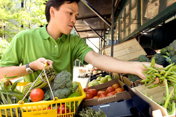 Man shopping at a mobile produce market