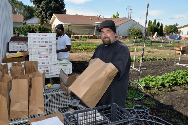 Mike Silva has been working full time for Dig Deep Farms in Alameda County for almost three years. The farm is a social enterprise founded by residents and law enforcement to provide healthy food to the community and to reduce recidivism by providing jobs for former inmates like Silva. Photo: Courtesy of Dig Deep Farms