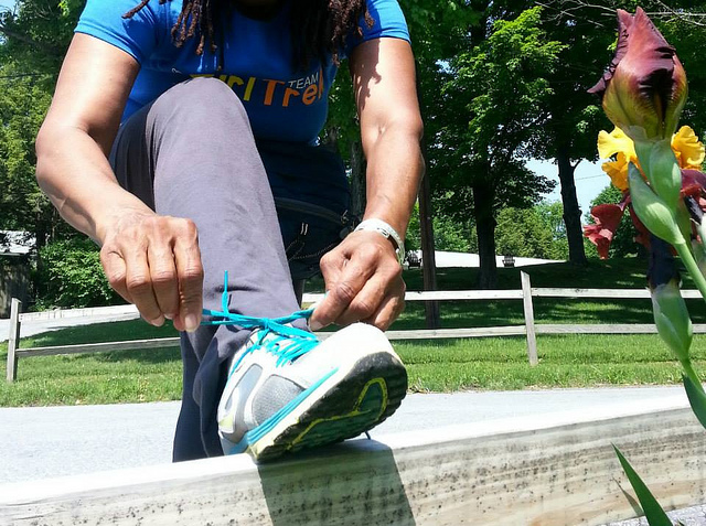 A GirlTrek member laces up before a walk in Oakland. Photo courtesy GirlTrek.
