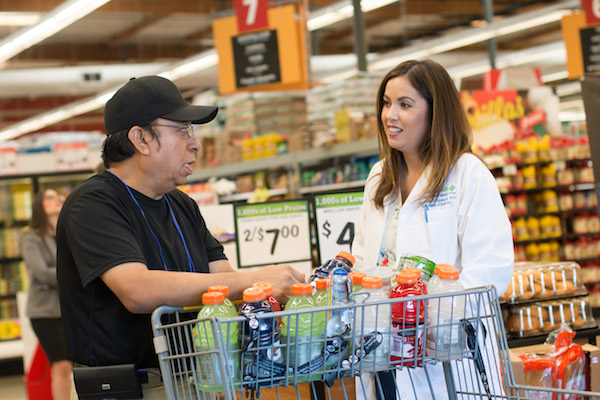 Luis Gregorio Ruiz and Dr. Maureen Villasenor discuss his purchases in an Anaheim grocery store. Photo: Jazley Faith Sendjaja