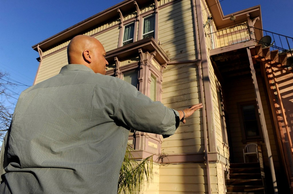 One of Alameda County's inspectors checks a house for lead poisoning. Photo courtesy of Alameda County Healthy Homes Department.