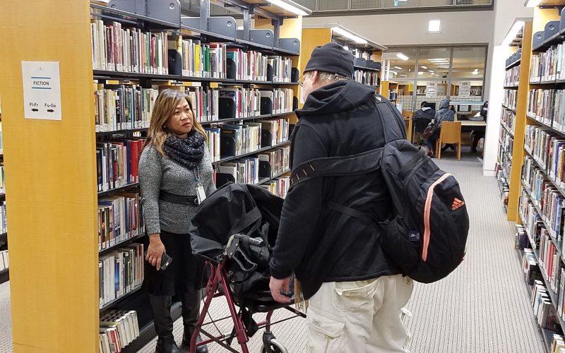 Unidentified homeless man, San Francisco Public Library