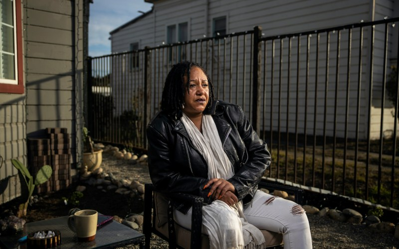 Cat Brooks, executive director of Justice Teams Network, a coalition of organizations dedicated to eradicating state violence, sits outside her home in Oakland, Calif. At 19, Brooks was severely beaten by her husband but when the police intervened, Brooks was taken to jail rather than her husband. Martin do Nascimento / Resolve Magazine