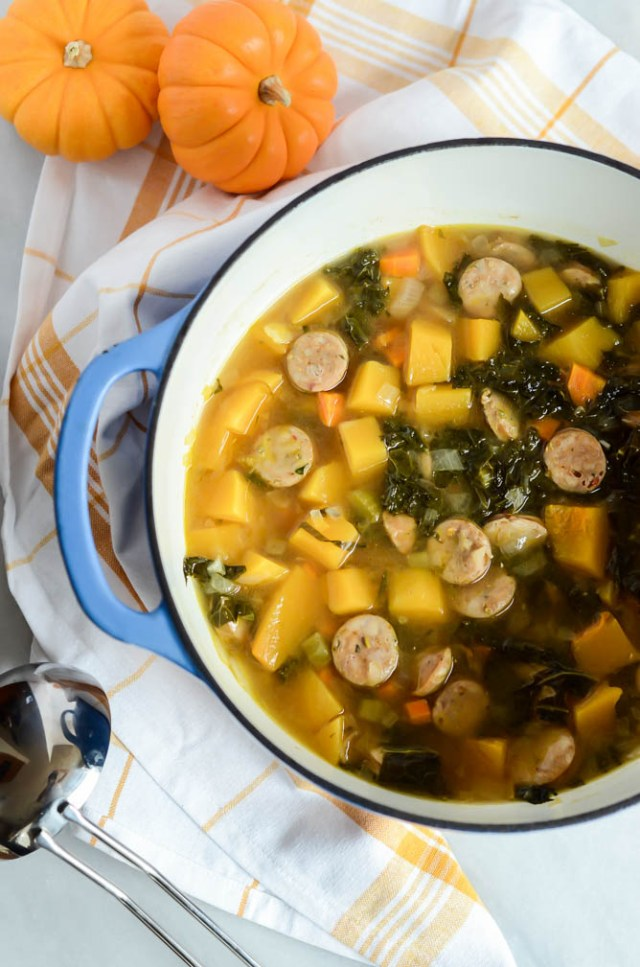 """A big pot of Butternut Squash and Sausage """"Stoup"""" with Crispy Brussels Sprouts is the perfect dinner to have linger on the stove on any busy night."""