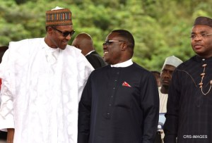 An ecstatic Ben Ayade, Governor of Cross River State, exchanges words with Muhammadu Buhari, President of the Federal Republic of Nigeria during the groundbreaking of the superhighway project in Nsan, Cross River State.