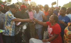 Abubakar Ewa, Boki LG Chairman, hands motorcycle keys on behalf of Bisong to a beneficiary