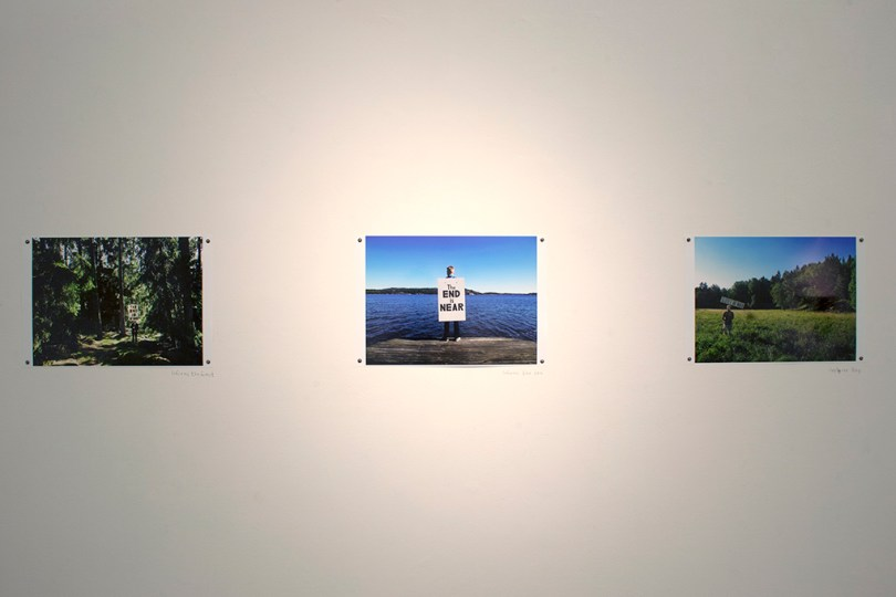 3 different photos hung on a white wall.