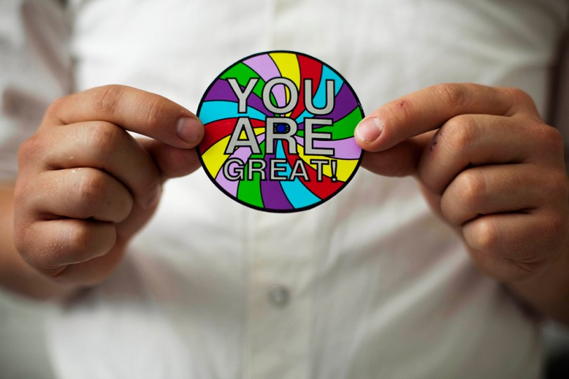 You Are Great! A round sticker with the text in silver letters and different colors in the background.
