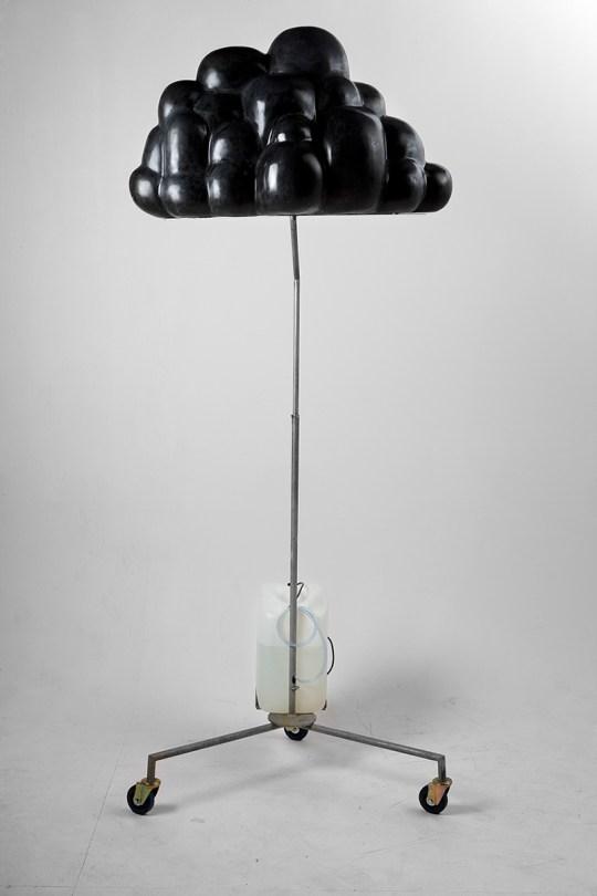 A black cloud on a metal stand. Sculpture.