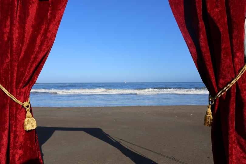 A drop curtain (like one from a theater stage) detached from the stage. Here you can see the pacific when looking through it.