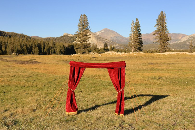 A drop curtain (like one from a theater stage) detached from the stage. Here it is placed in Yosemite.