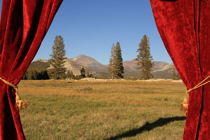 A drop curtain (like one from a theater stage) detached from the stage. Here you can see Yosemite when looking through it.