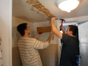 Bob and John removing tile