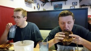 Bob and John are digging in to their brisket melt sandwiches. Yummy!