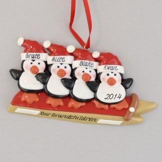 Grandchildren 4 Penguins Sledding Personalized christmas Ornament
