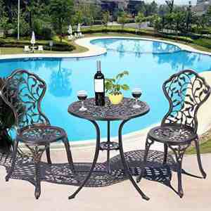 A wide patio garden area and a water pool with Patio Bistro Set