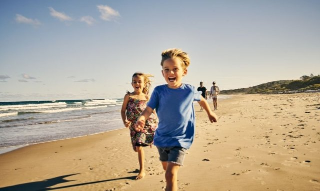Boy and Girl playing at beach area on Outdoor Travel